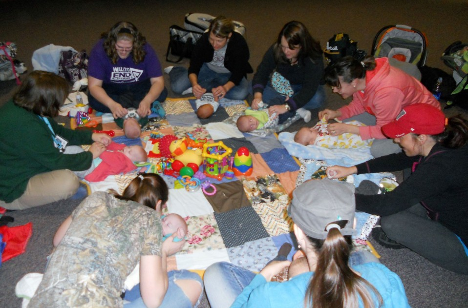 Group participating in a Baby & me class